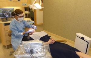 Dentist Flossing Patient