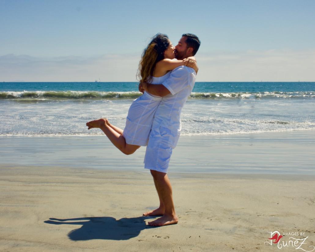 Angelita Kissing Juan on Beach