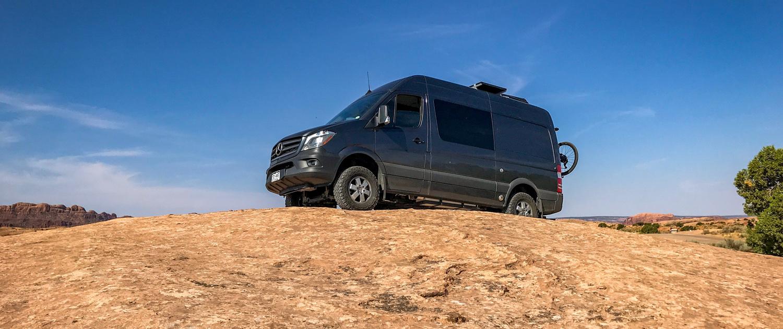 Blue Mercedes Van Conversion on a Hill