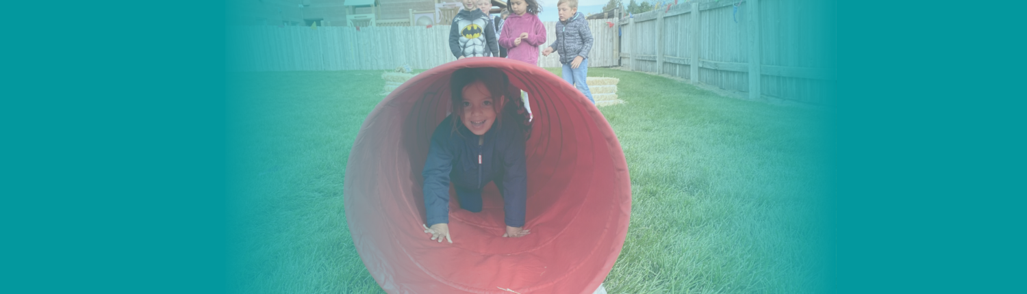 Children Playing in a Tube
